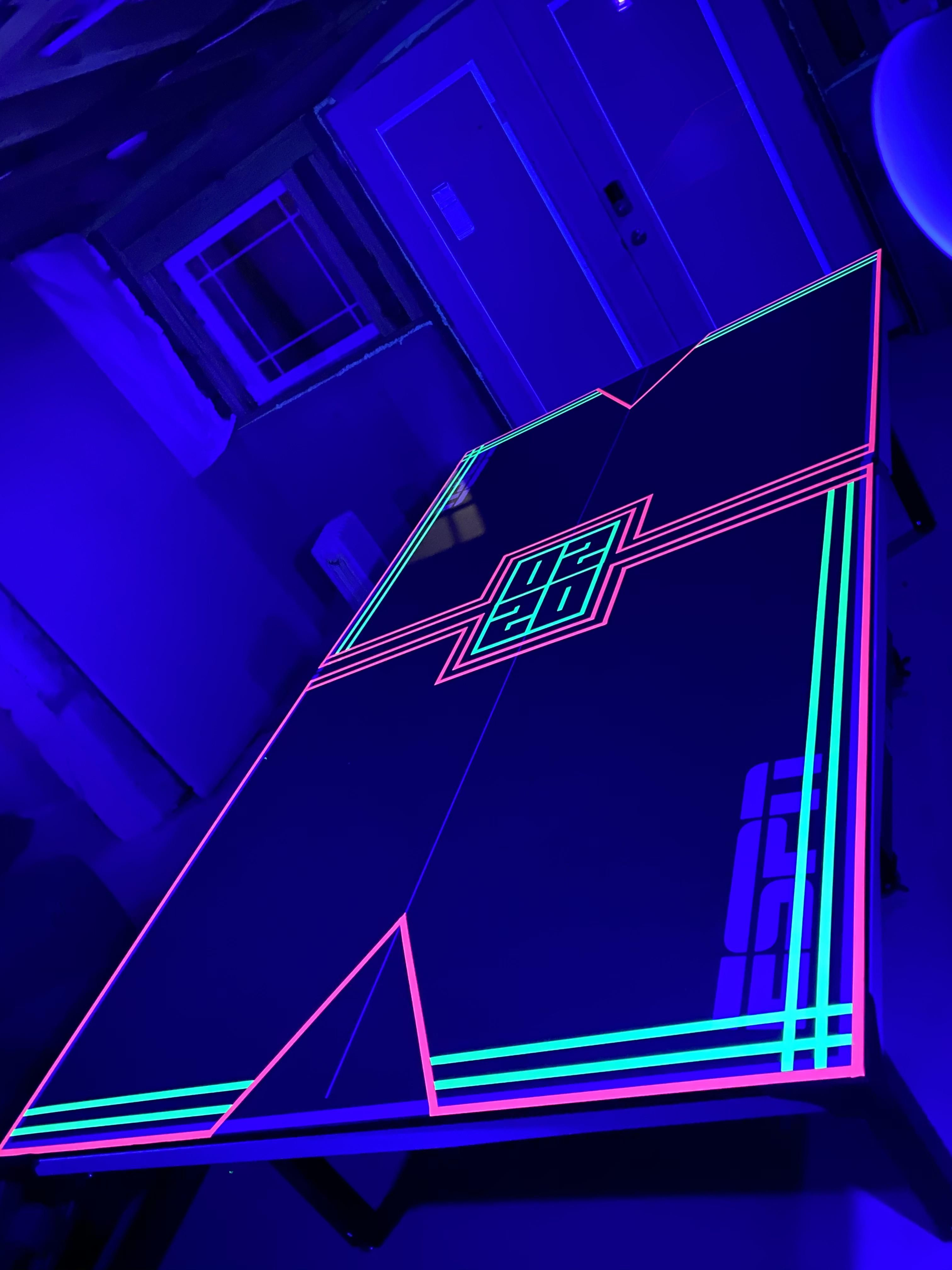 A ping pong table I decorated with florescent tape for my