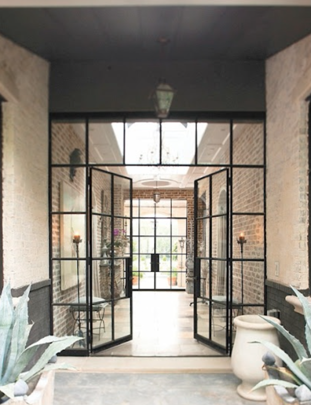 13 Examples Of Industrial Doors Amplifying An Interior | Airows