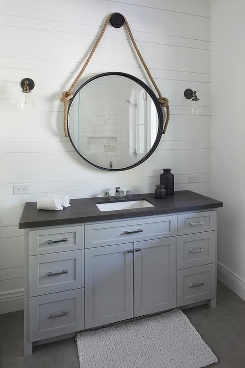 Exquisite Cottage Bathroom Boasts A White Bath Mat Placed In Front Of A  Steel Gray Washstand