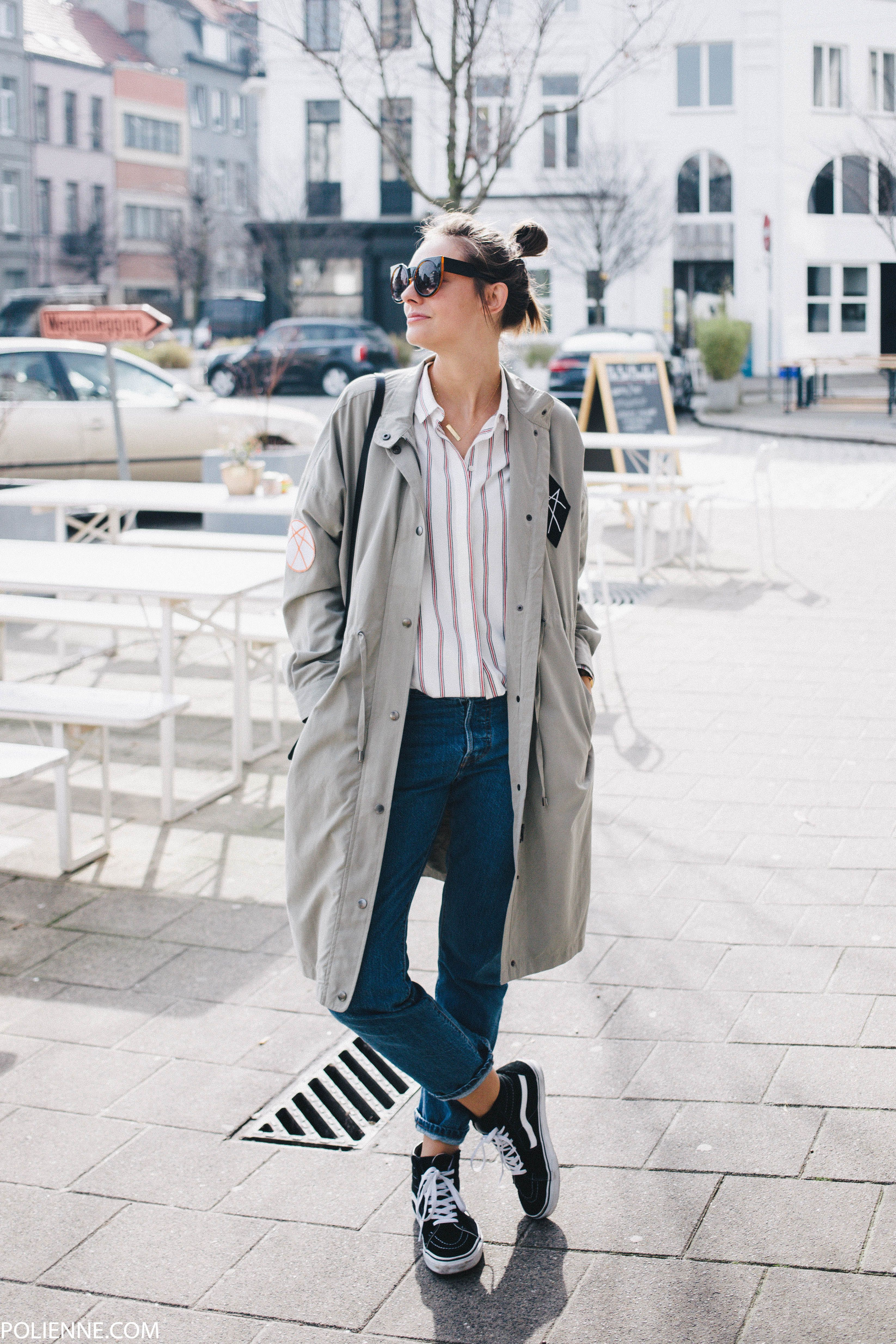 Monday morning vibes in sneakers, blue jeans, and a striped blouse.