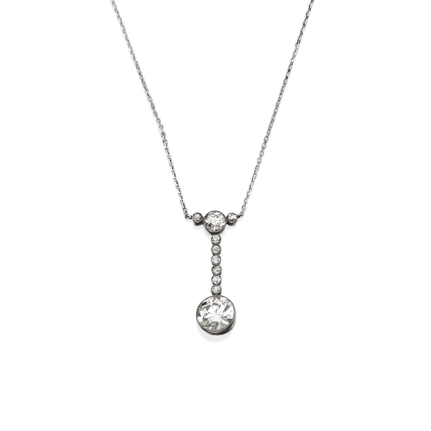 An art deco diamond pendant on chain the bezel set old european cut