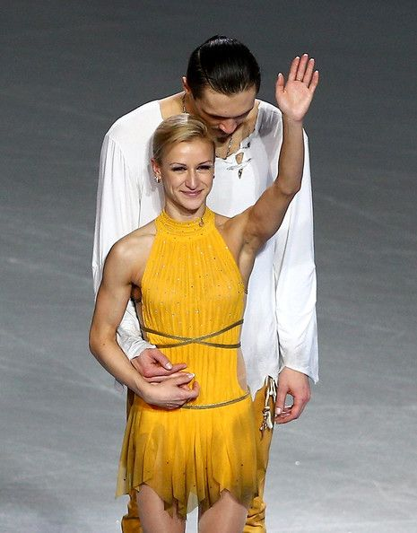 Gold medalists Tatiana Volosozhar and Maxim Trankov of Russia on the podium during the flower ceremony for the Figure Skating Pairs event du...