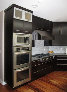 View Of The Double Wall Ovens, Built In Microwave, Gas Cooktop, And Hood..  Modern Kitchen