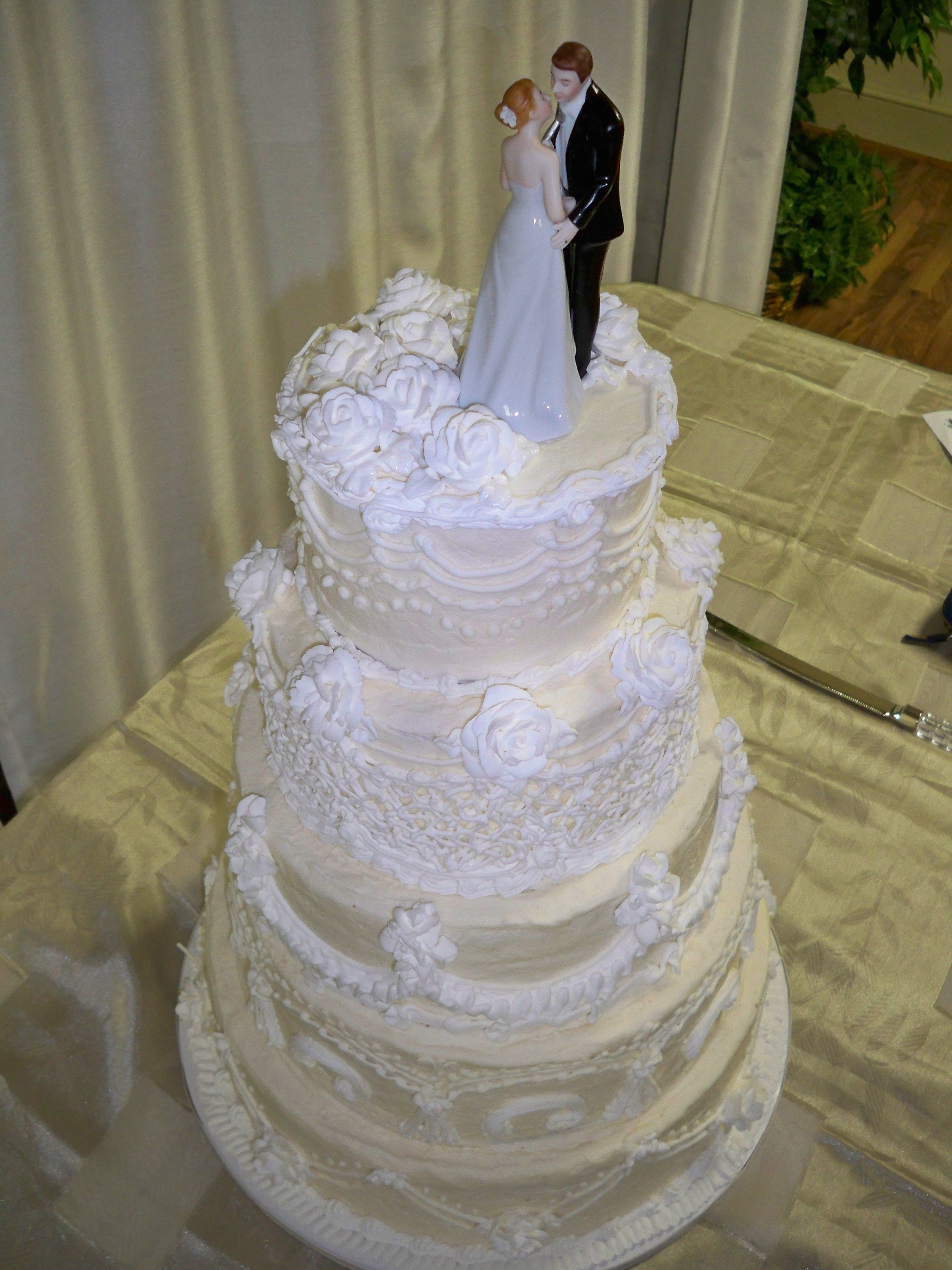 Classic old school hand pipped wedding cake on cream cheese frosting