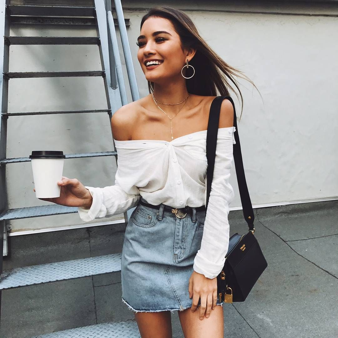 White Shirts Creating An Off The Shoulder Look With A Xute Denim Skirt And Belt