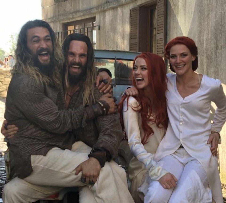 Amber Heard And Jason Momoa Photos Photos: Jason Momoa On Set Just Sitting On The Lap Of Stunt Double