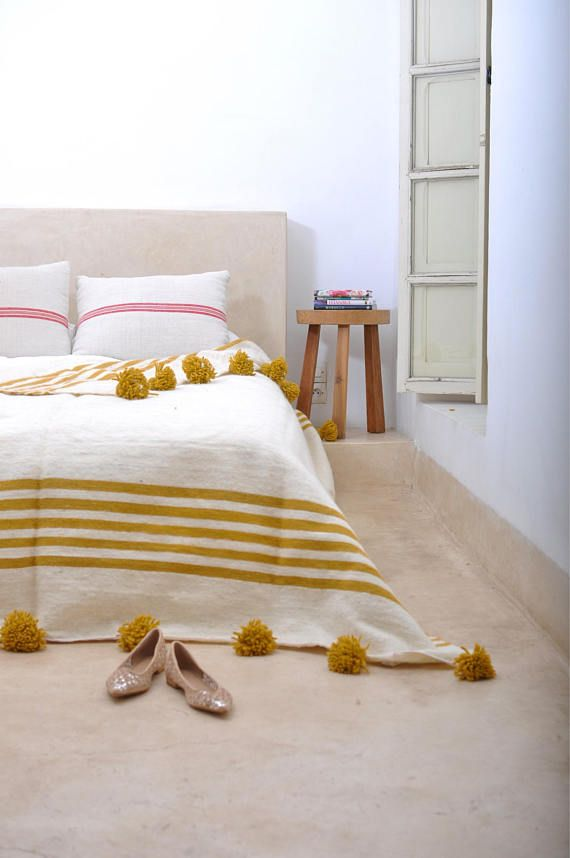 A Perfect Marriage Of The Old And The New Our Pom Pom Blankets Are Handwoven On Traditional Wooden L Moroccan Pom Pom Blanket Moroccan Pom Pom Pom Pom Blanket