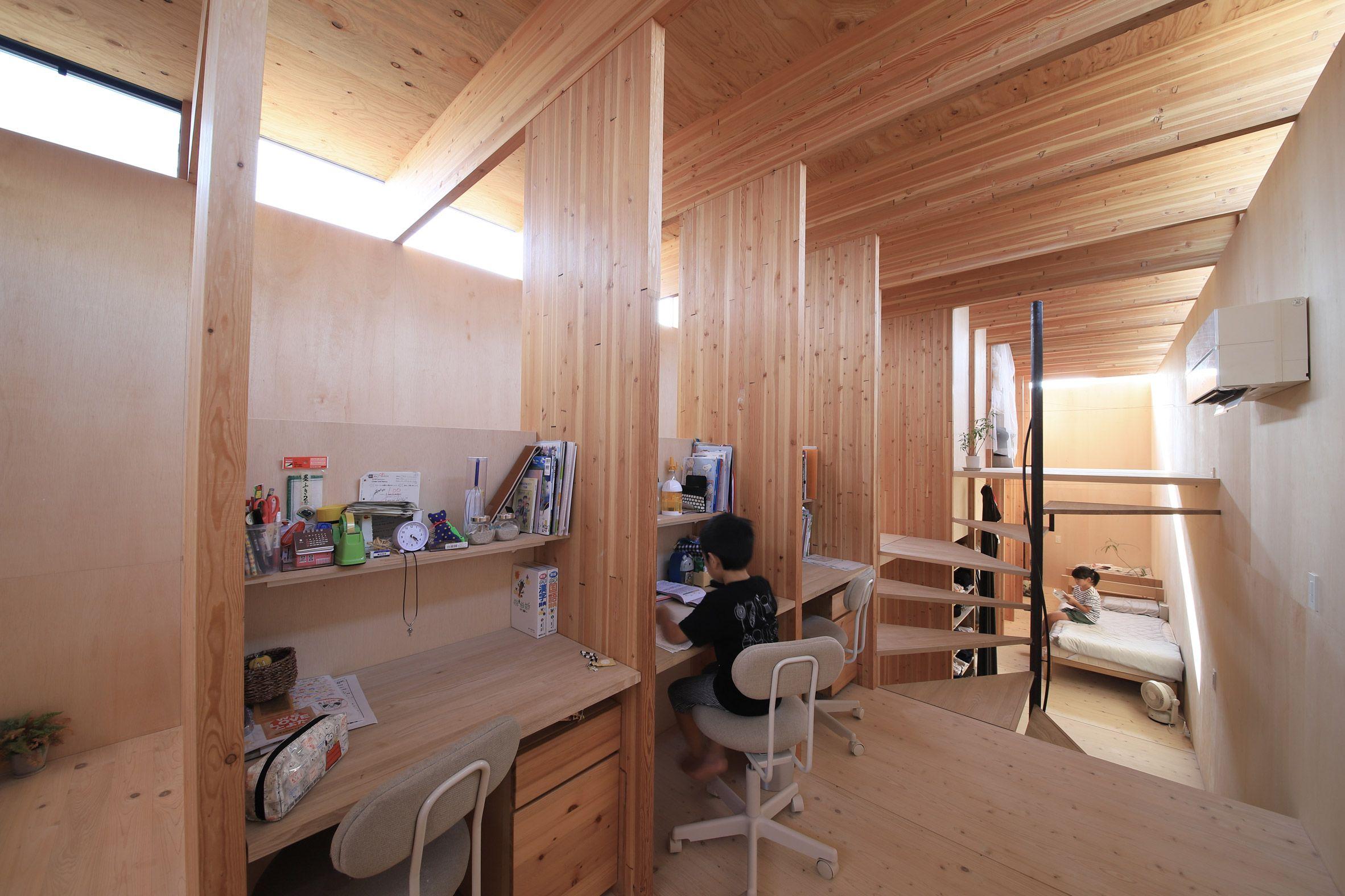 Katsutoshi sasakis minimalist home has a dark exterior and a light