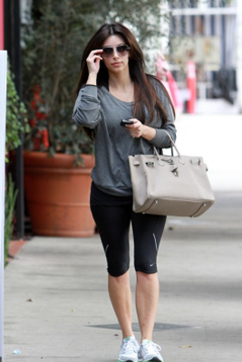 f7828478ca7c Kim Kardashian wearing Nike capris Hermes Birkin Bag in Gris Tourterelle  American Apparel Lightweight Raglan Pullover Nike Everyday Fit+ Trainers  Chanel ...