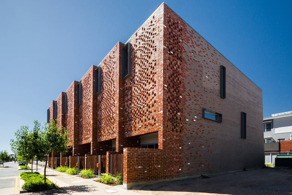 Brick brisesoleil eight perforated brick facades
