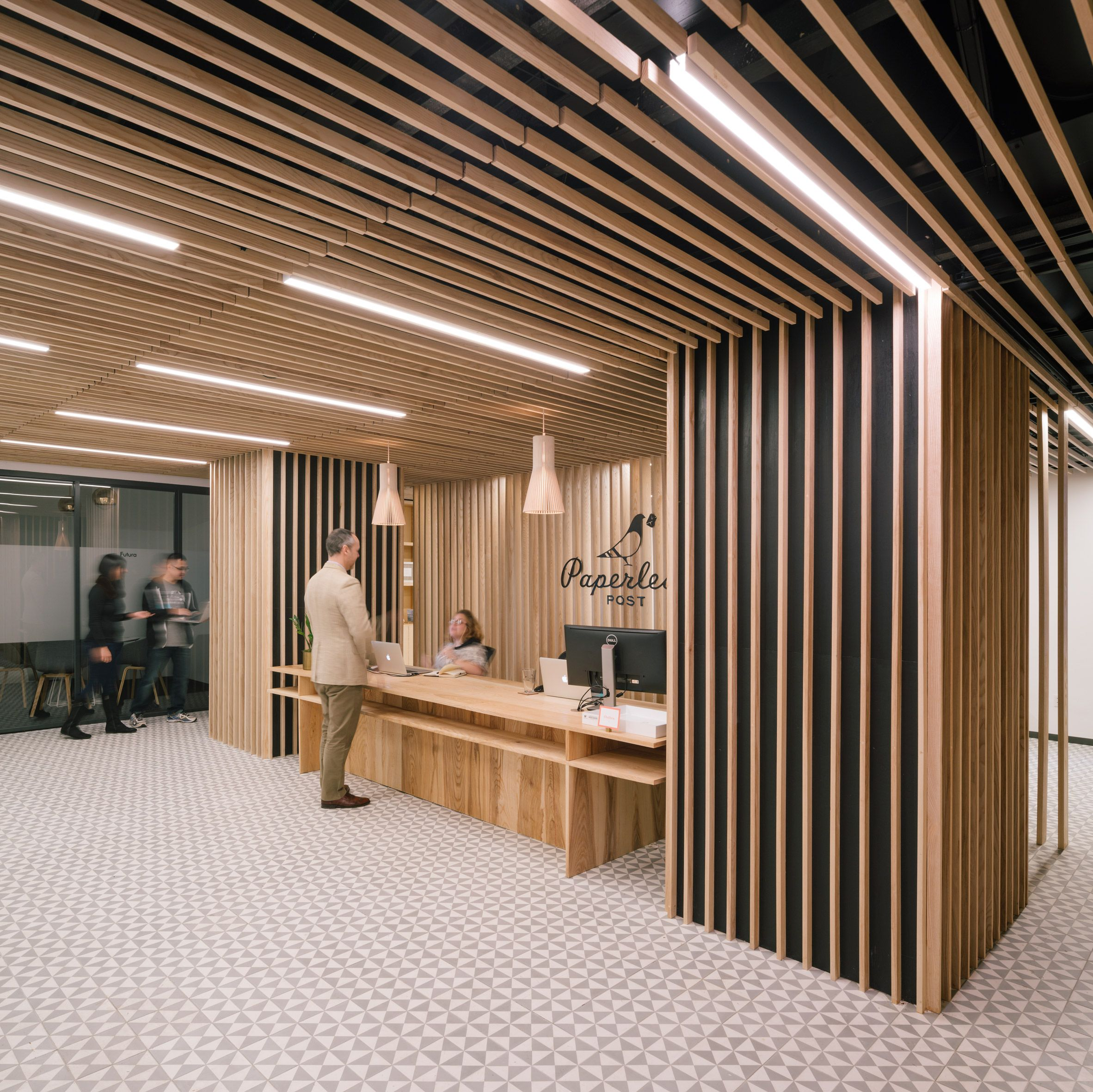 Wooden slats surround reception at Paperless Post's