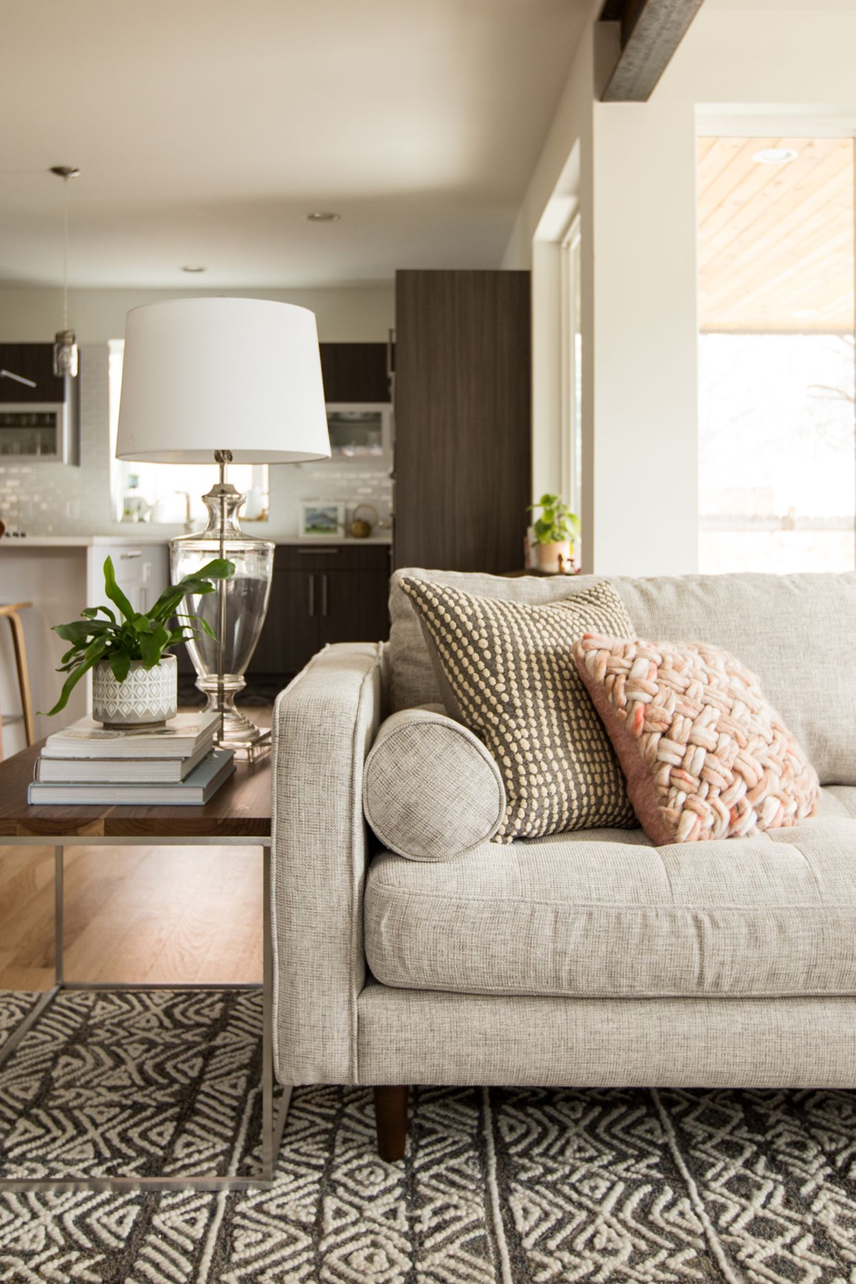 The lines of the couch and low profile of the back are ideal and give our modern living room update the right sensibility the lines of the couch end and