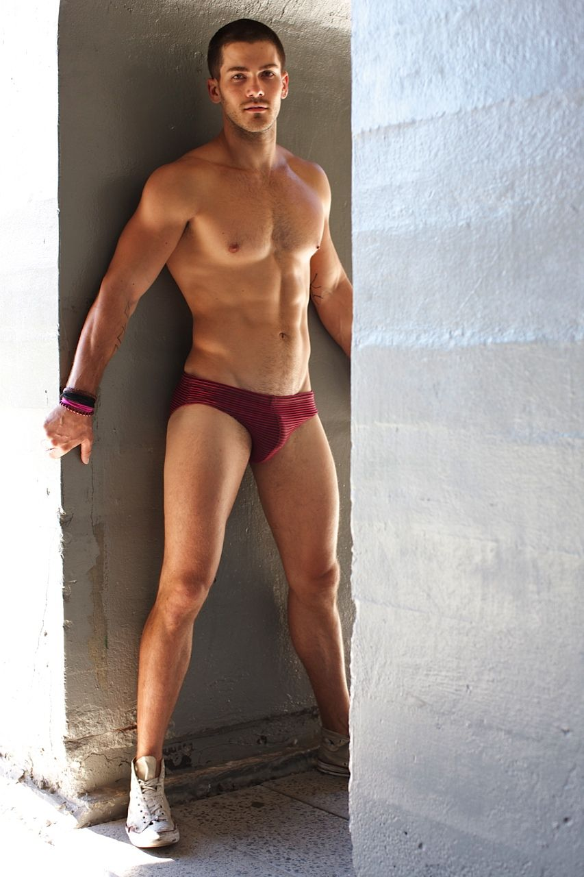 745dda39b7714 Eddie Granger models the new Brown and Magenta Lagos swim brief for Mr. Turk  in a simple, seductive The product will be available in October.