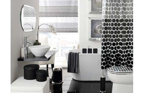 Black accessories, white fittings and grey floor and walls