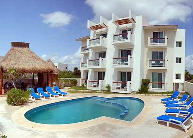 2 bedroom beachfront condos with good sized pool.  WiFi, Air Con, Sat TV! in Akumal