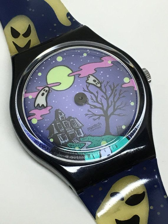 This is a rare and very unique Swatch Watch known as Geisterstund GB192. It is running and keeping perfect time with a new and included battery. The bands, moon, and hour markers glow in the dark (I can provide a photo). This watch is in great condition. There is a crack to the underside of the band with holes near the watch. This can be seen best in the fifth photo. The bands are original. The big ghost is the minute hand, and the small ghost is the hour hand. There is no second hand…