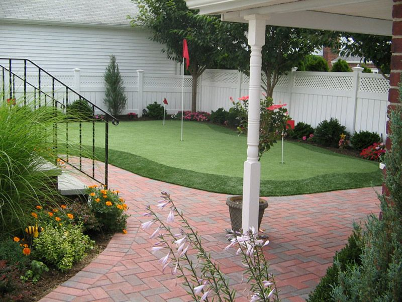Beautiful backyard installation with putting green from ...
