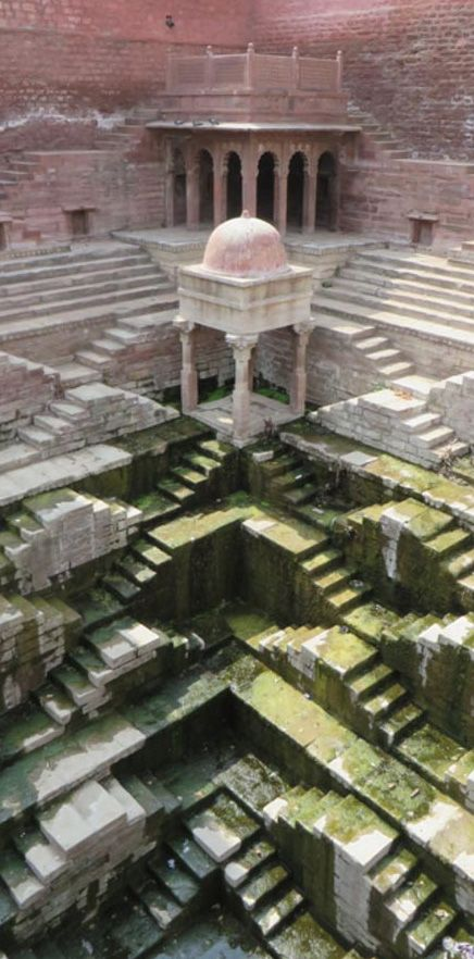 Imagine a country so dry that you have to build a 10-level stepped structure going down into the earth to get water. Such is India, where thousands of stepwells were built from the 2nd through the 19th century. Many have been abandoned and are in disrepair since the introduction of modern waterworks and plumbing. Some have been destroyed. Now largely obsolete, these Escher-like cisterns were once monuments of public life. And in the midst of water shortage, stepwells may refill their civic…