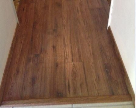 Home decorators collection distressed brown hickory 12 mm thick x 6 1 4 in wide x 50 25 32 in length laminate flooring 15 45 sq ft
