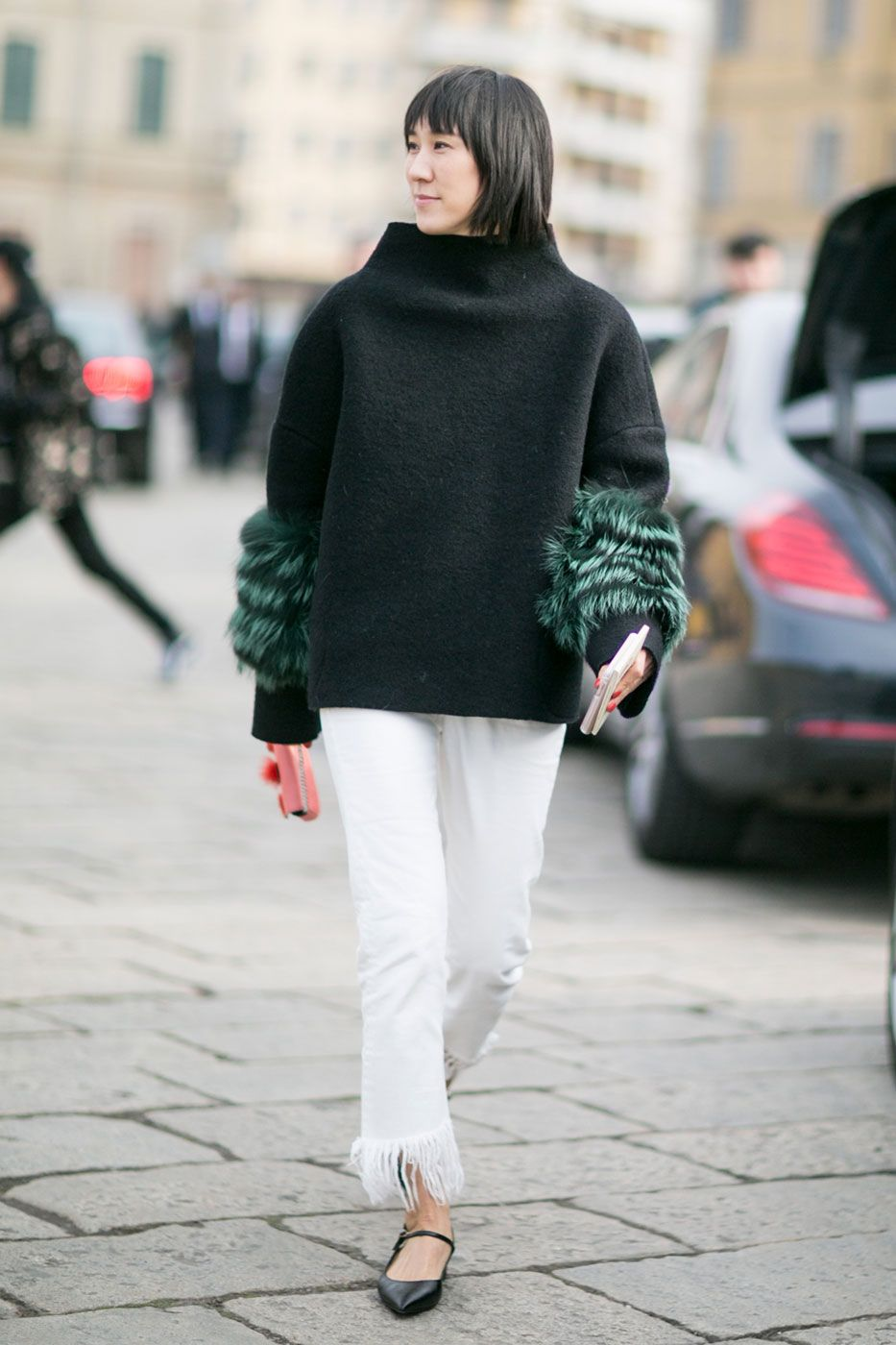 A black sweater met green sleeves on a white pants, so classy and comfy. Milan Fashion Week