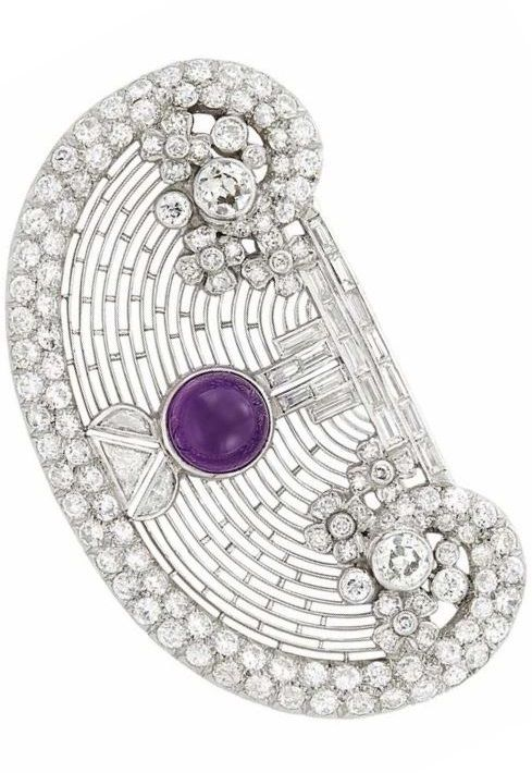 Art Deco Platinum, Cabochon Amethyst and Diamond Brooch. One round cabochon amethyst, 134 old European-cut, round, baguette, triangular and half moon-shaped diamonds, circa 1925. #ArtDeco #vintage #brooch