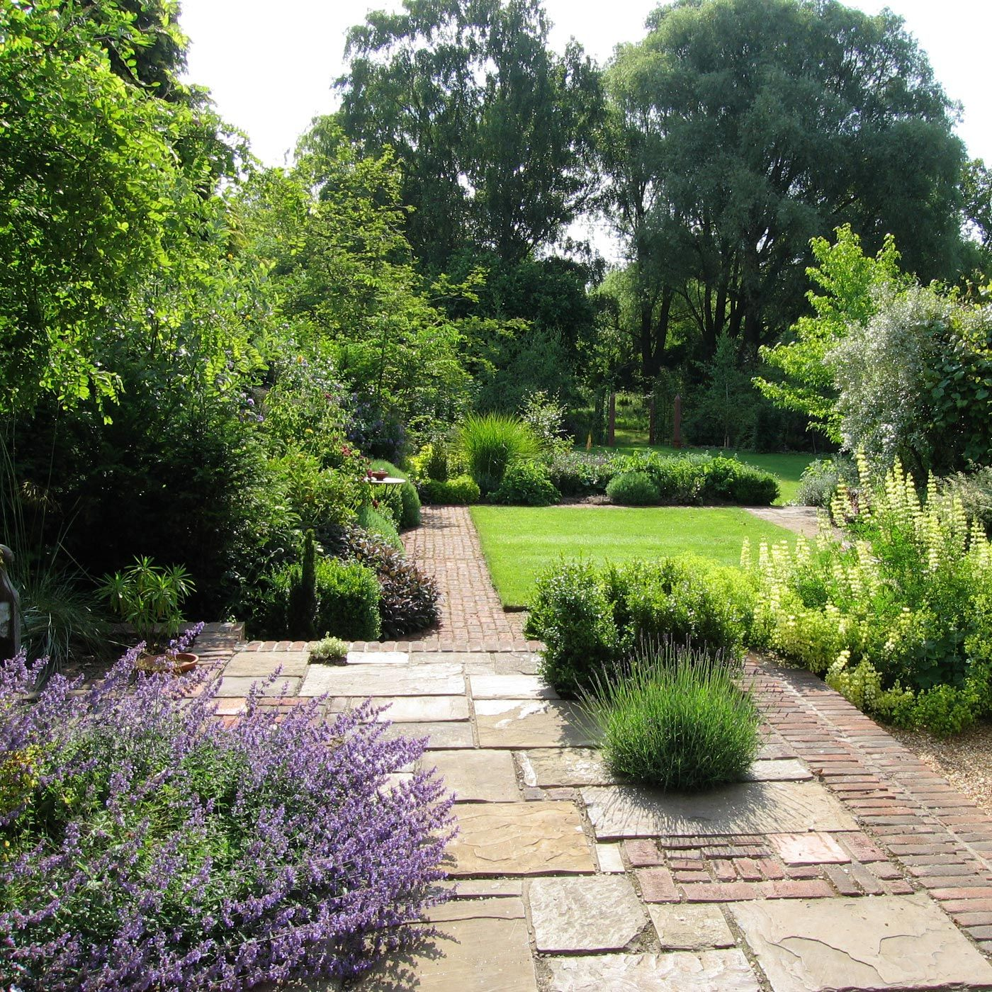 a thatched cottage garden backing onto water meadows