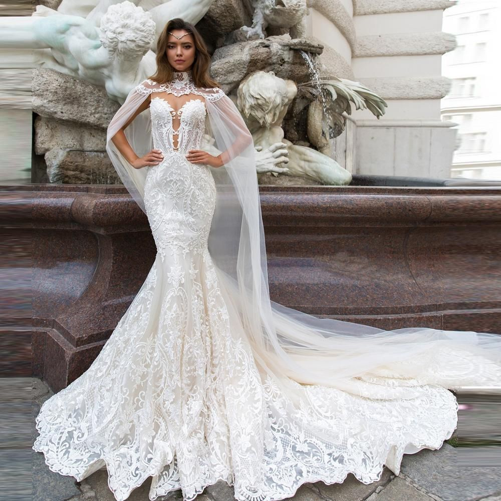 Beautifully Elaborated Mermaid Wedding Dress With Button Down Back And Detachable Wrap Bolero Included In 2021 Sheer Wedding Dress Lace Mermaid Wedding Dress Beaded Wedding Gowns [ jpg ]