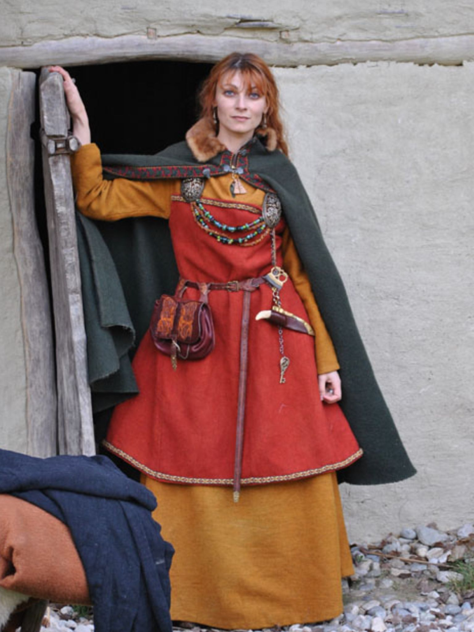Please read this about apron dress decoration: http://urd.priv.no/viking/smokkr.html Please read this site about belts: http://www.medieval-baltic.us/vikbuckle.html
