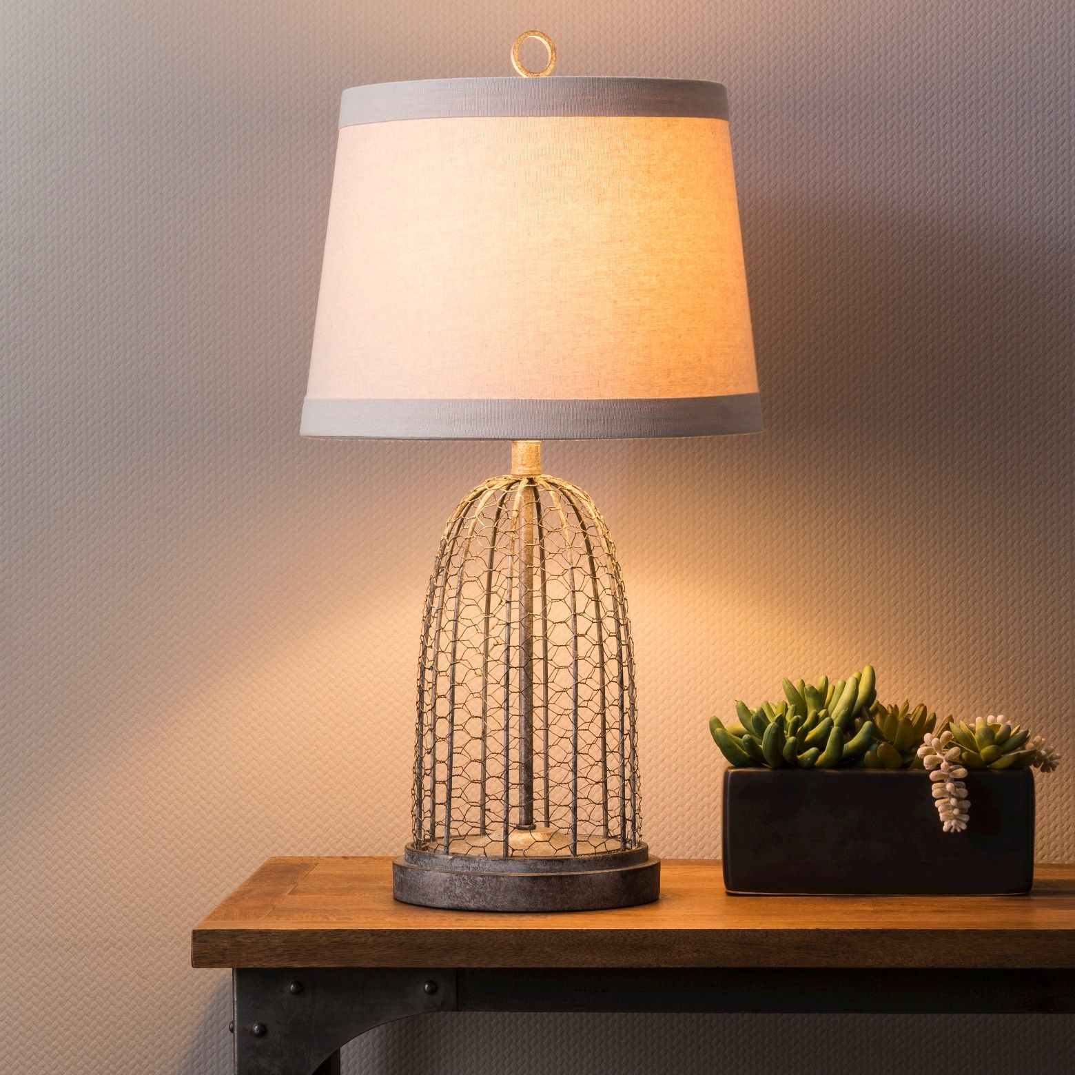 Metal and resin• inspired by vintage cloche made of bird chicken wire cagethe baiter table lamp in grey wire from beekman 1802 farmhouse was