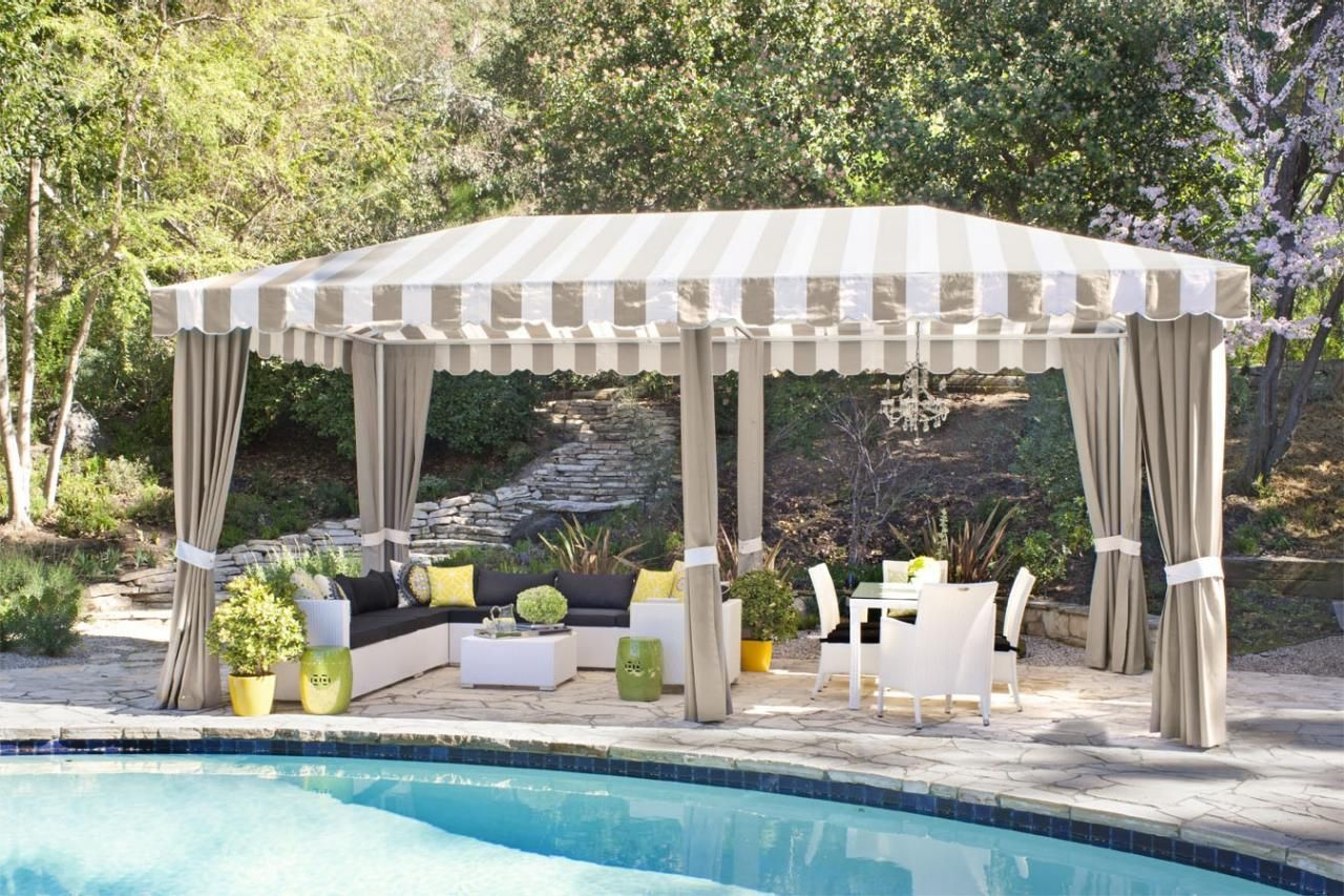 A Striped Awning Covers The Poolside Cabana Of This Contemporary Home ~  Woven Outdoor Furniture