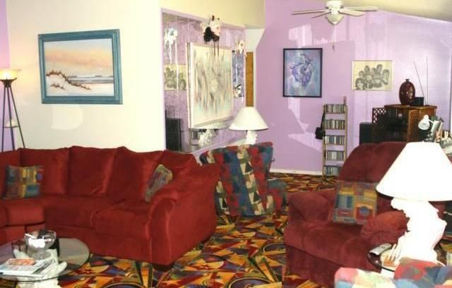 living room ugly tacky gaudy Las Vegas type colorful carpet chairs