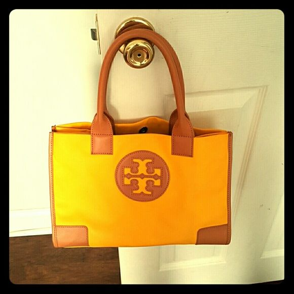 cdaf0f1e37e Ella Mini Tory Burch Tote handbag Sunny yellow nylon with tan leather  trim.Magnetic snap closure.Top handles have 7