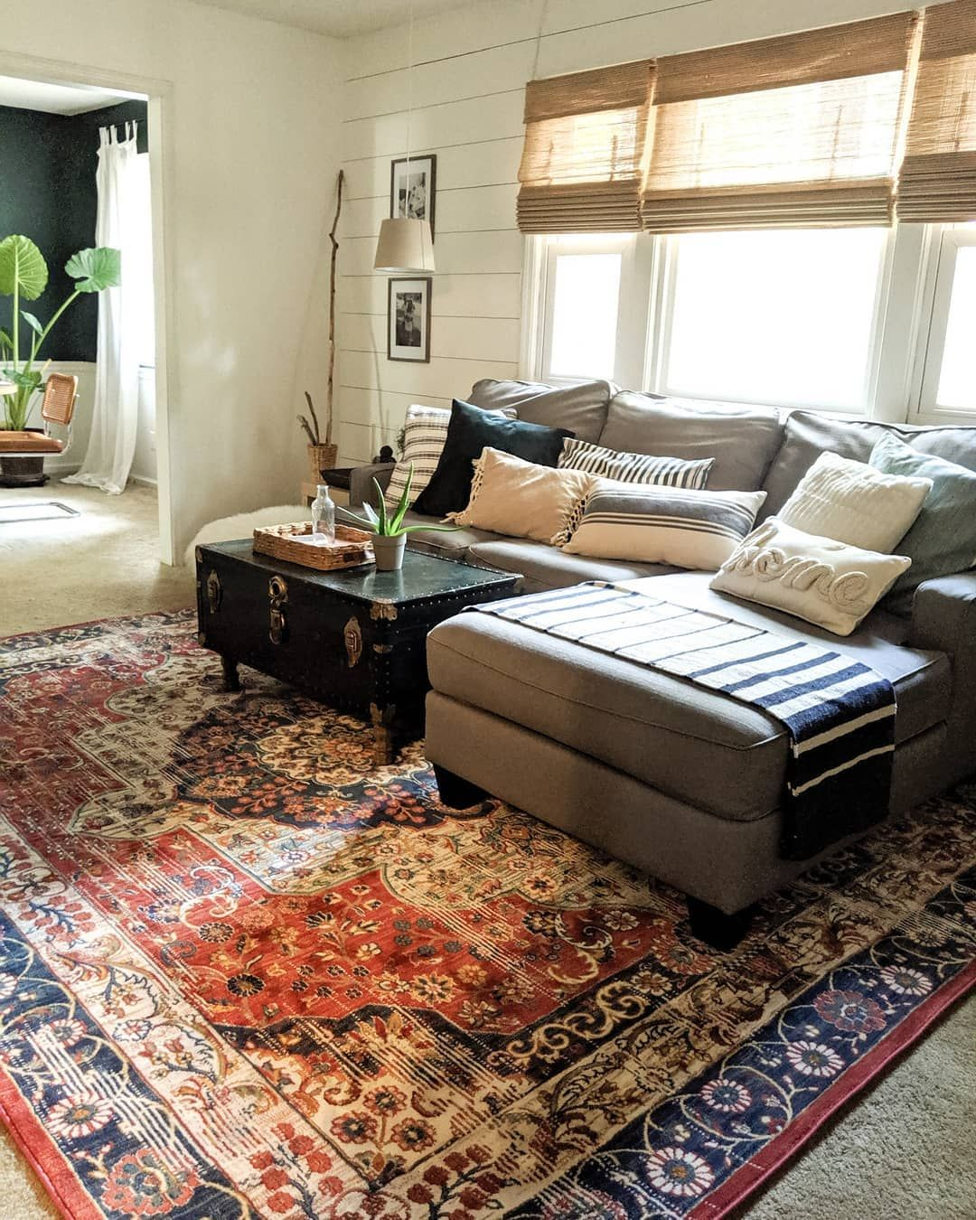 Boho Chic Living Room With Trunk Coffee Table And Well Woven Rug