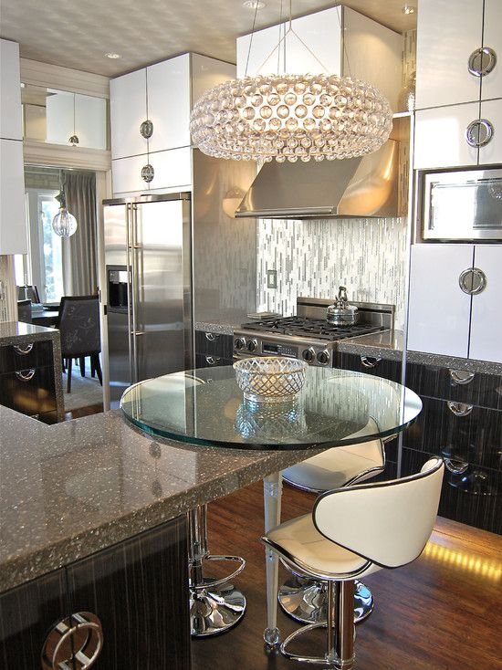 .Kitchen - Circular counter top mirroring the round crystal chandelier above adds total glam and great impact to the kitchen space.