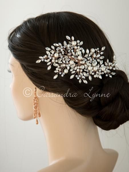 2ea03e753 Dozens of round and marquise Swarovski stones along with ivory pearls  create this stunning bridal spray. This style brings a delicate and  beautiful look to ...