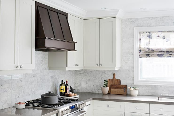 Gorgeous White Kitchen Boasts A Coffee Stained Wood Vent Hood