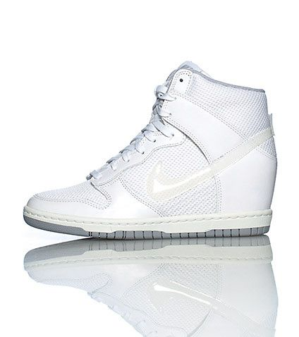 7f0cfc0ae2e NIKE High top women's wedge sneaker Lace up closure Mesh for breathability  Padded tongue with NIKE logo Cushioned inner sole