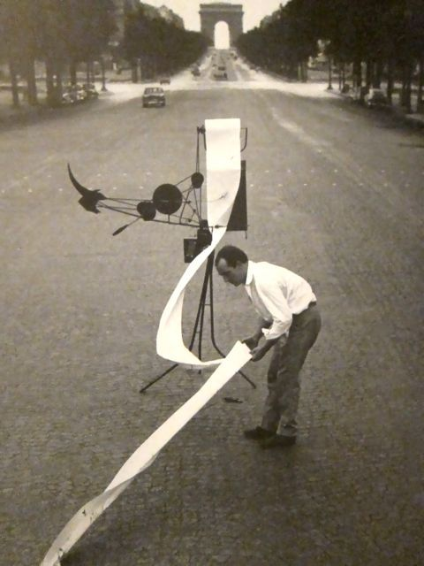 Jean Tinguely working with Meta-Matic No. 17 on the Champs-Elysees, Paris, 1959