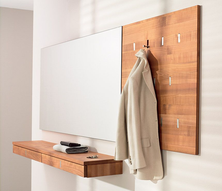 Team7 coat rack has slimline, integrated, flush-mounted folding hooks -  unobtrusive when