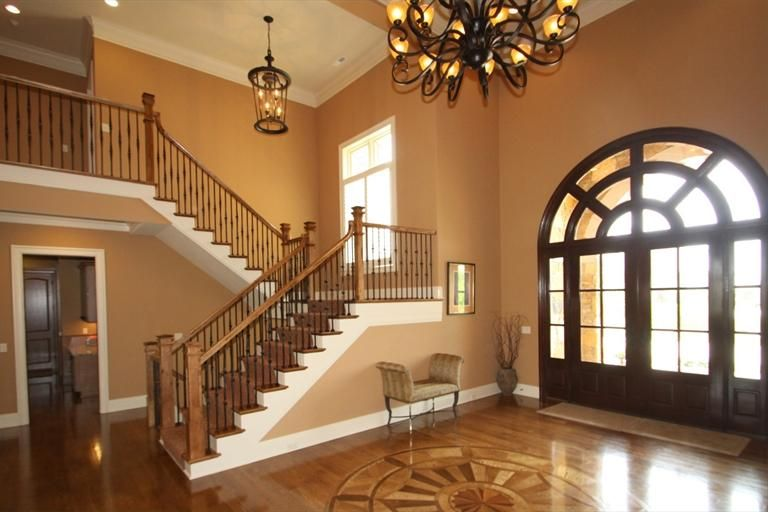Jamie Foyers Traditional : Inlaid wood floor design for this foyer the home