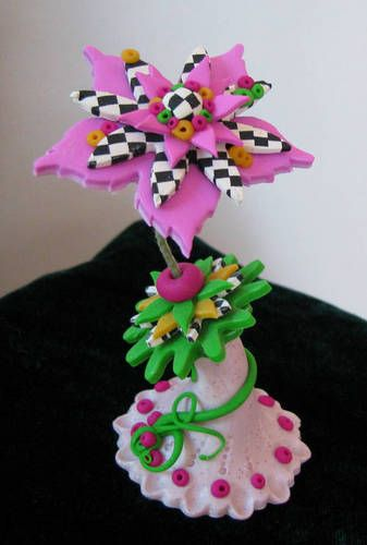 This crazy little flower makes me want to break out the polymer clay,