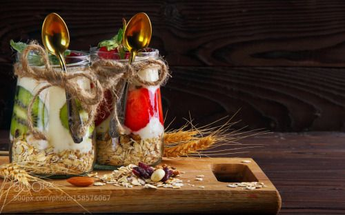 Two jar with hommemade oat flakes with fresh yogurt with kiwi an by IvanZhukevich  IFTTT 500px