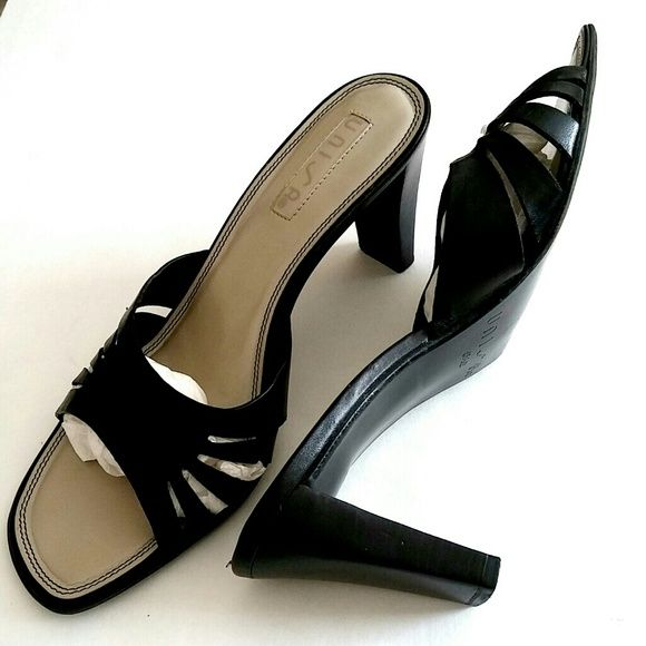 Unisa Mules Comfortable & cute with a 3in. heel, these black sandals are all kinds of right with all kinds of apparel.  A girl simply cannot have too many pairs of black shoes! Unisa Shoes Heels