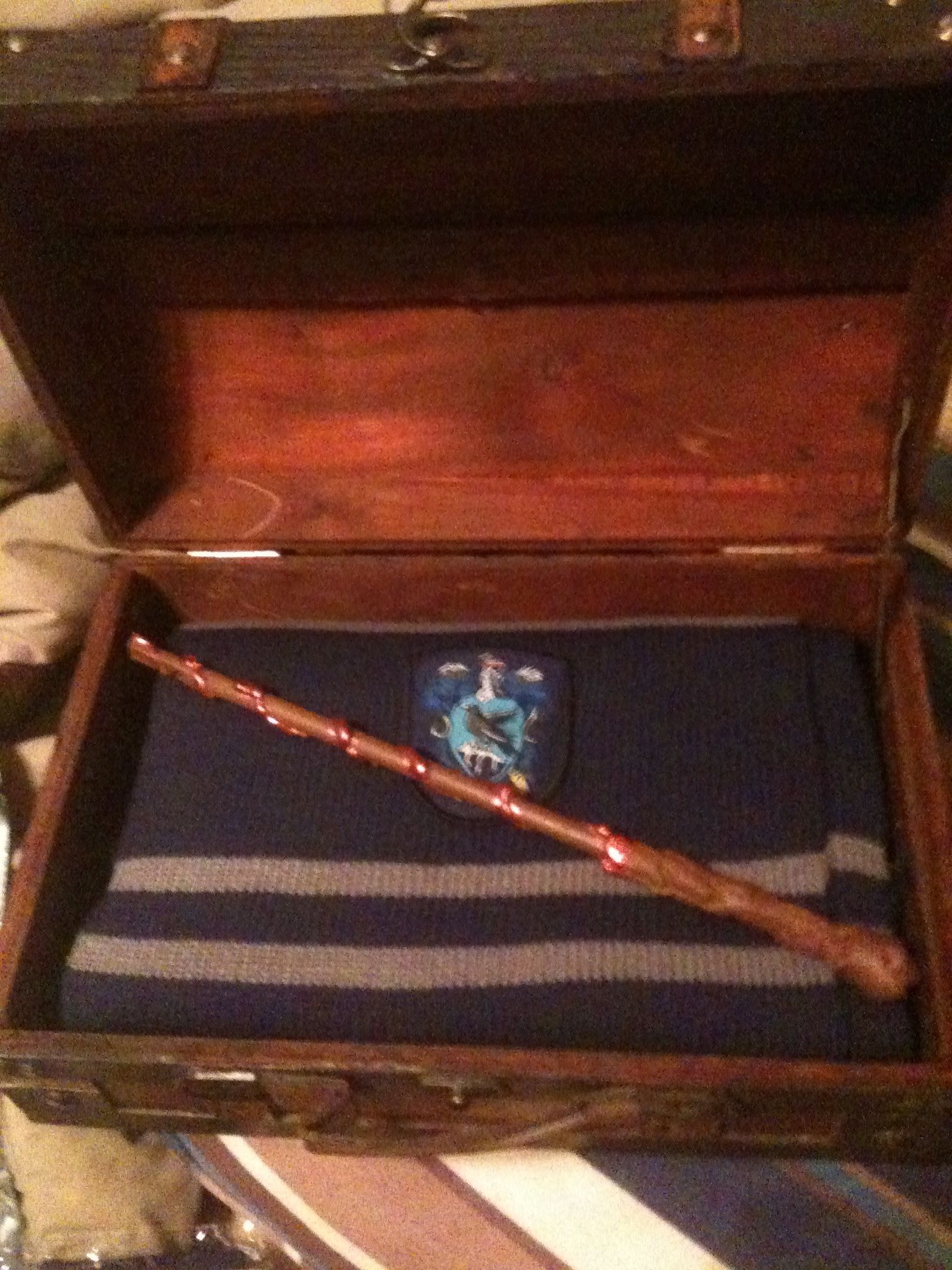 DIY Harry Potter gift set. Small chest, put in it the desired house swag, a custom wand, as well as other items like ticket to platform 9 3/4, Hogwarts acceptance letter, or any thing else of the like! Wand was made with craft wood, hot glue, and acrylic paint.
