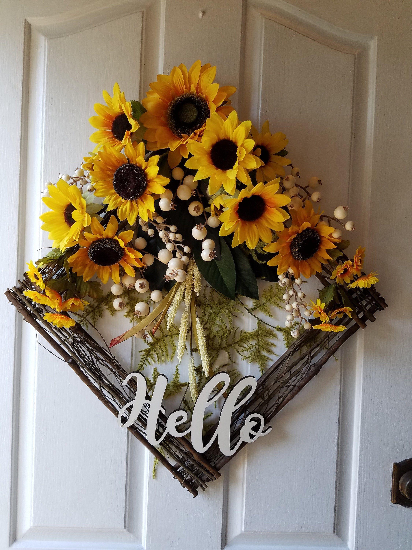 Photo of Sunflower wreath with shield, trap door decor, wreath for front door