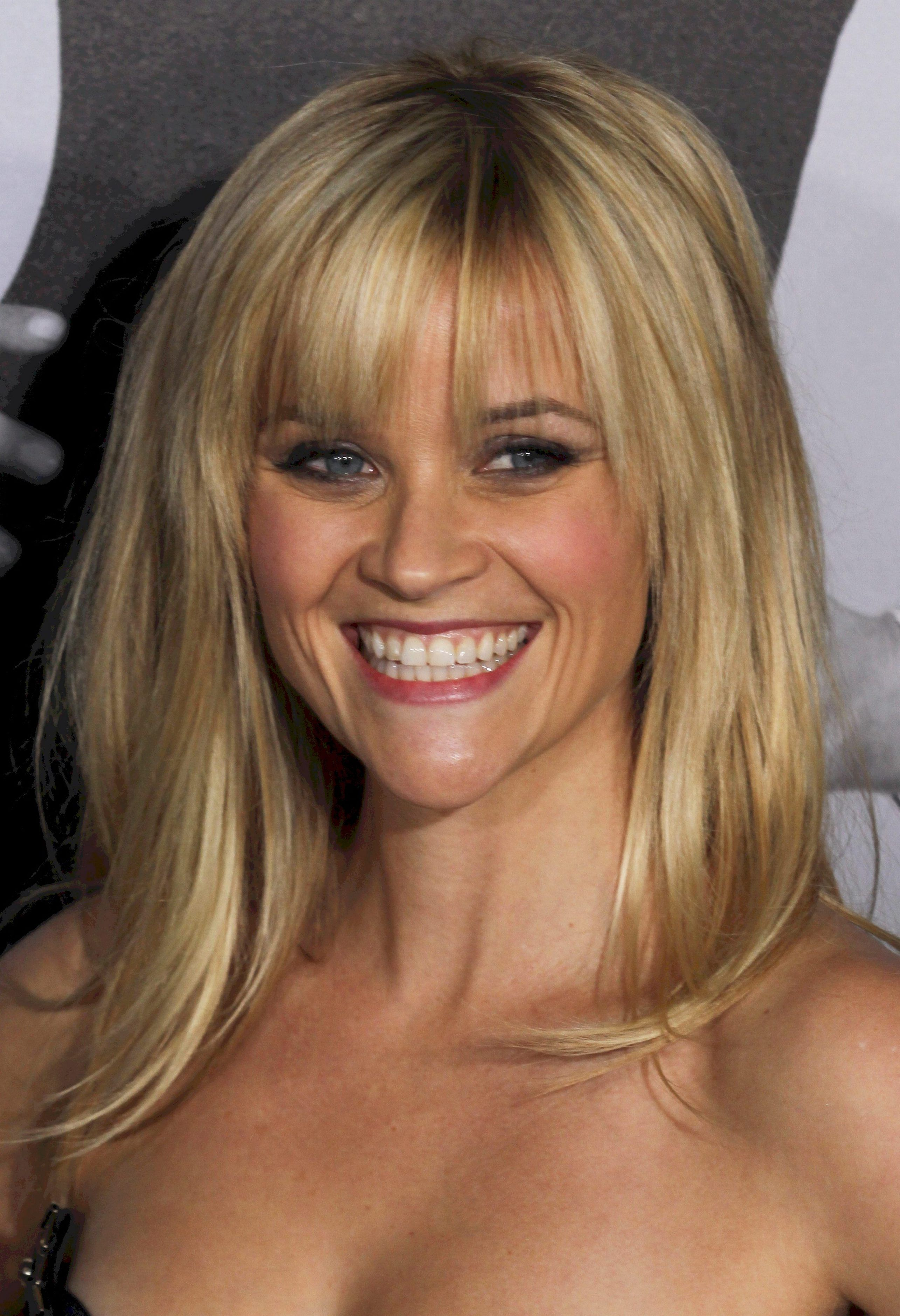 reese witherspoon. bangs and shoulder length.   girly-ness