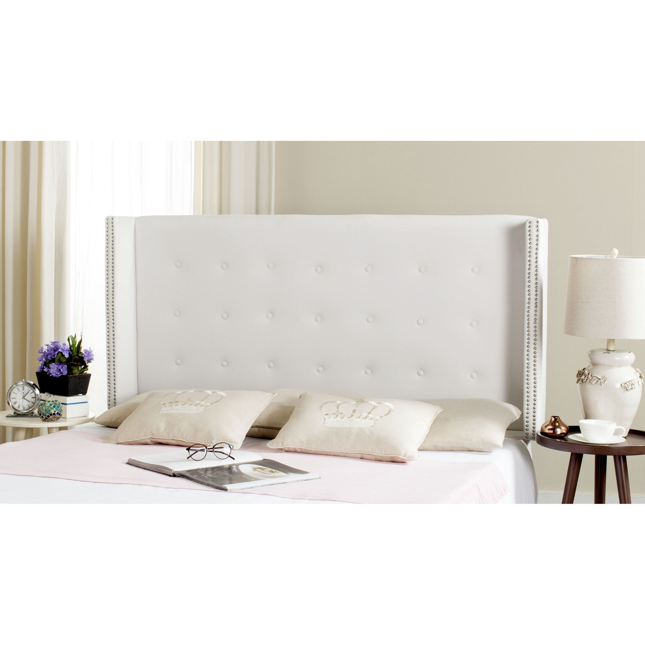 Posh and polished, this modern winged headboard brings glamour and intrigue  to the contemporary boudoir. Upholstered in a cool pewter hue, its tufting  and ...