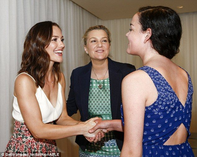 Meet and greet: The Friday Night Lights actress beamed as she welcomed a guest with a hand...