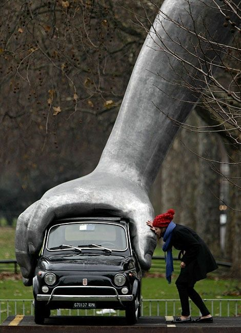 "sculptor : Lorenzo Quinn with a classic Fiat 500 ""Park Lane, London"""