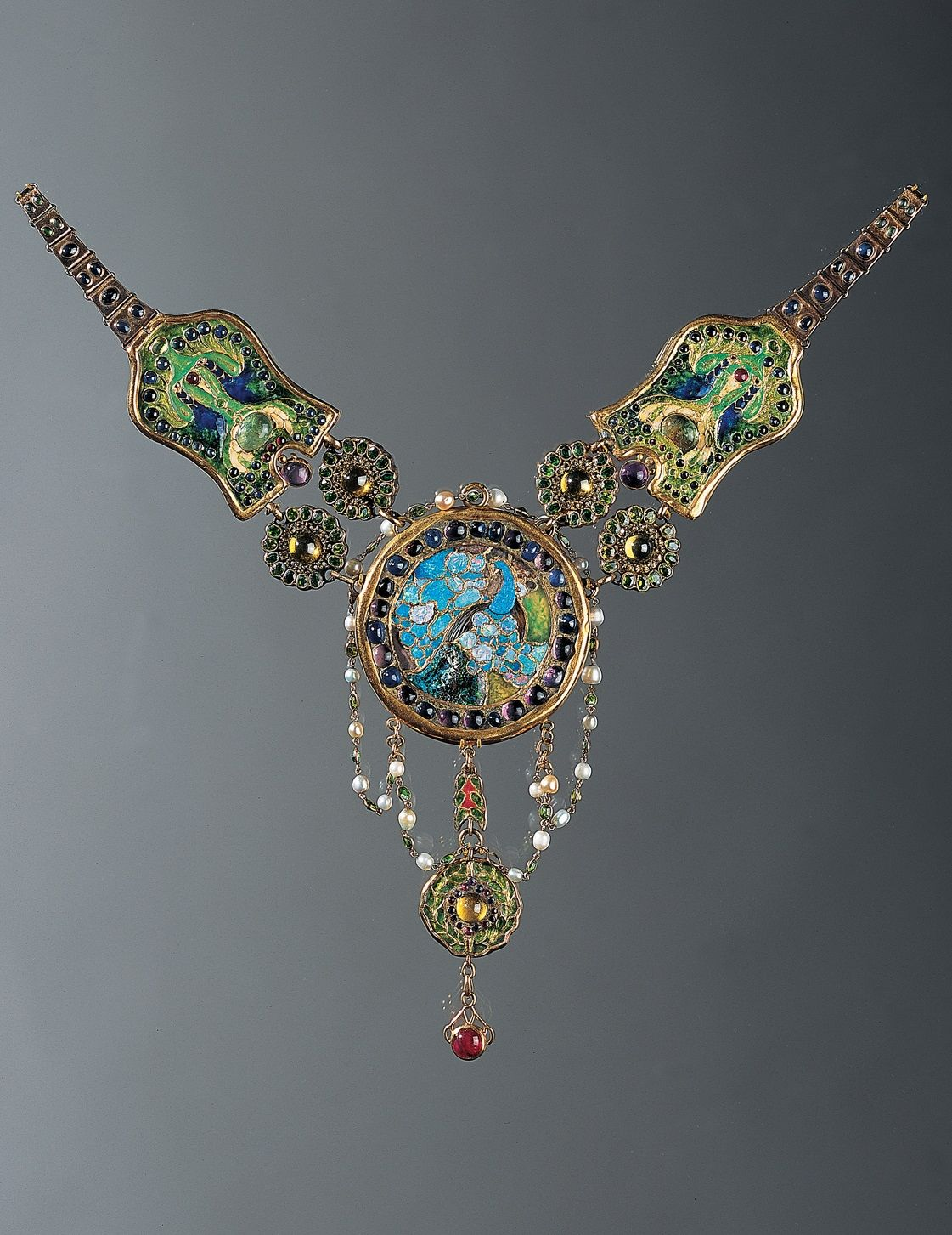 'Peacock and Flamingo' necklace, by Louis Comfort Tiffany for Tiffany & Co., executed by Julia Munson [Sherman], circa 1903. Exhibited at Salon of the Société des Artistes Français, Paris, 1906. Composed of enamel, opal, amethysts, rubies, sapphires, demantoid garnets, emeralds, chrysoberyls, pearls and gold. Signed TIFFANY & Co.